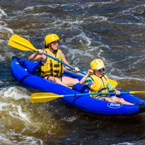 Dog Leg Rapid in a Sport Yak with Kids